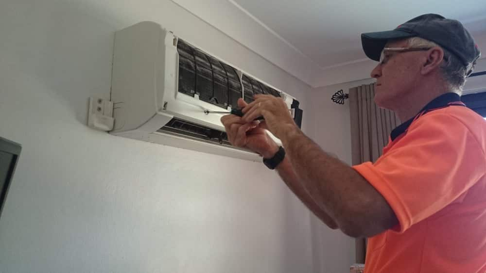 Screwing an aircon cover