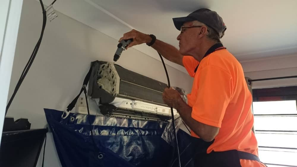 Covering an aircon prior to cleaning